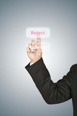 "A Man presses a ""reject"" buttion"