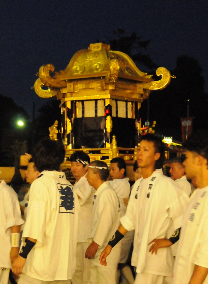 young men carrying the mikoshi