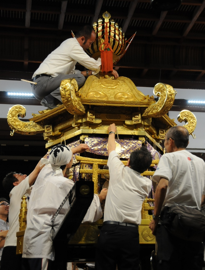 dressing the mikoshi in gold again