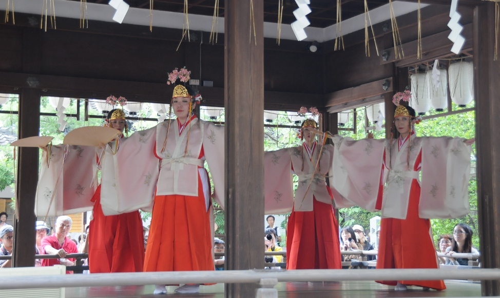 shrine maidens performing a sacred dance