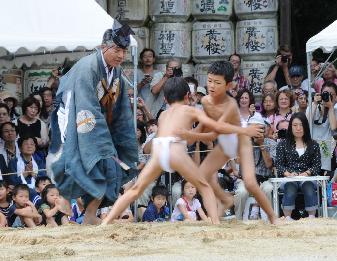 two boys sumo wrestling