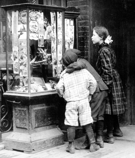 children looking at a store window with Christmas cards, 1910
