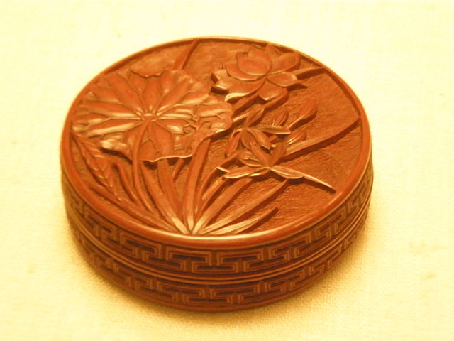 carved lacquer on round box