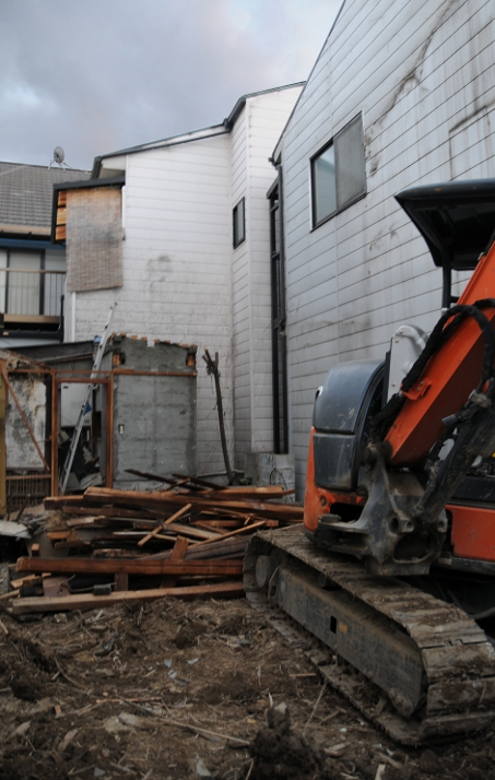 demolished house with bulldozer