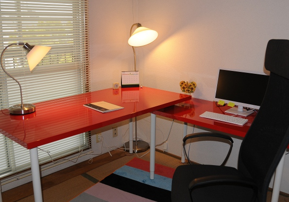 two bright red IKEA desks in my office