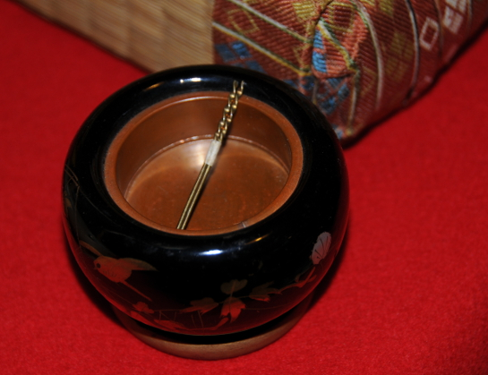 miniature hibachi with iron chopsticks