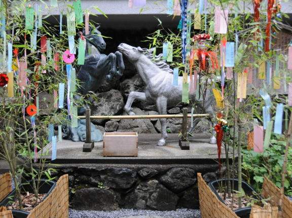 Statues of white and black horses at Kifune Shrine