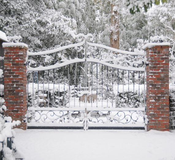 Snowy path with gate
