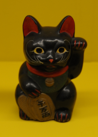 black manekineko with lucky koban coin