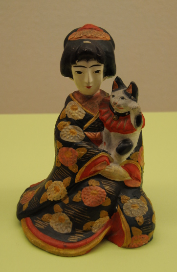 geisha figurine with maneki neko