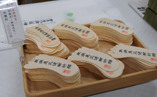 Prayer cards in the form of feet