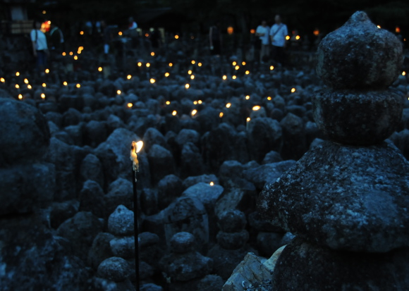Lit candles during sento kuyo festival
