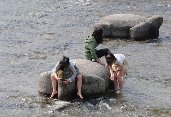 Kids playing in Takano River