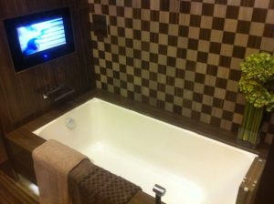 Bathtub with TV in front