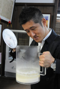 Kotaro inspecting the almost done sake