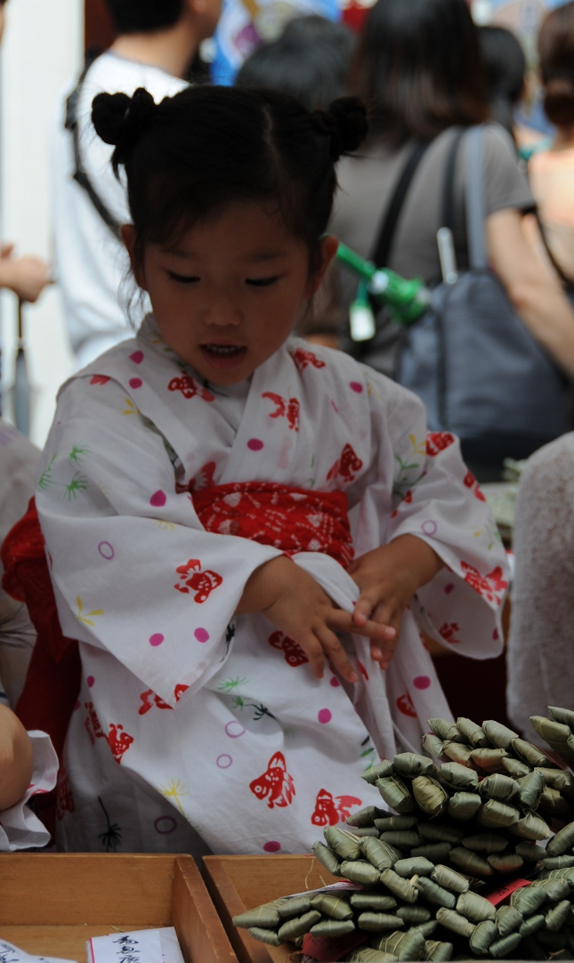 very young seller of charms