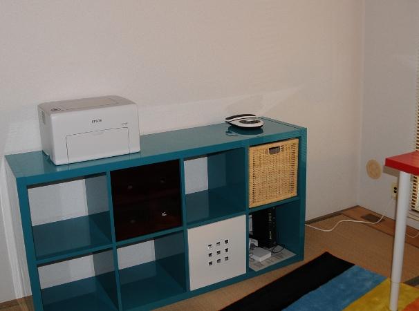 blue IKEA KALLAX shelf in the office