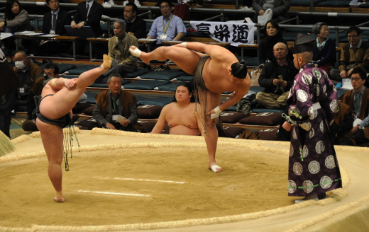 Two sumo wrestlers preparing for their bout