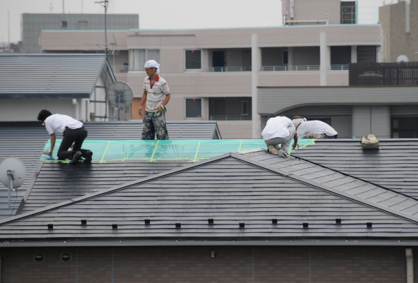 fixing the roof with ducttape