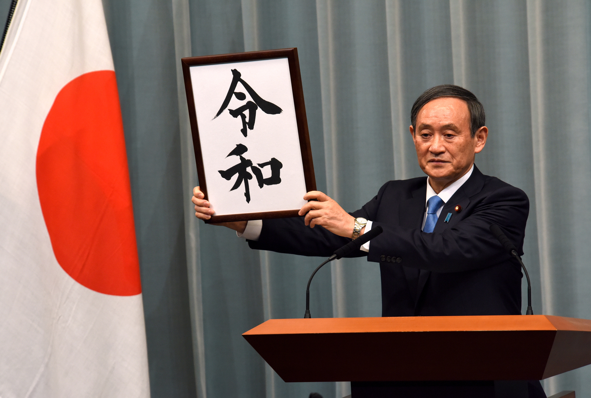 Yoshihide Suga , Chief Cabinet Secretary announces the name of Japan's forthcoming new era